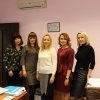 Сотрудницы финансово-экономической службы «НИПИ нефти и газа УГТУ» и Т.А. Бузыкаева в центре
